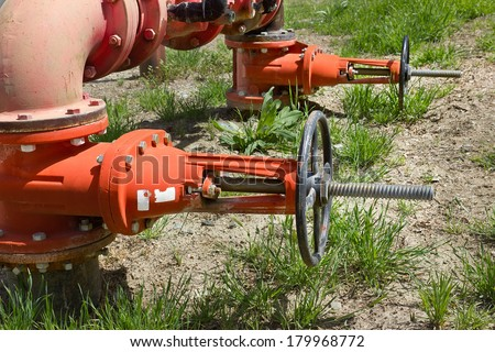 Outdoor water system supply pipe and valves. - stock photo