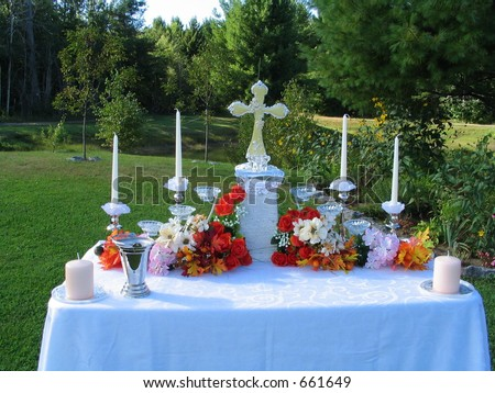 outdoor wedding altar set for ceremony with lawns and trees - stock photo