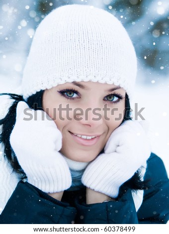 Outdoor winter portrait of beautiful smiling young girl - stock photo