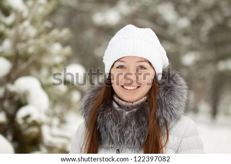 Outdoor winter portrait of girl in wintry clothes - stock photo