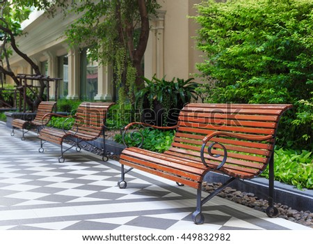Outdoor wood bench furniture in the hotel for people to sit and chat