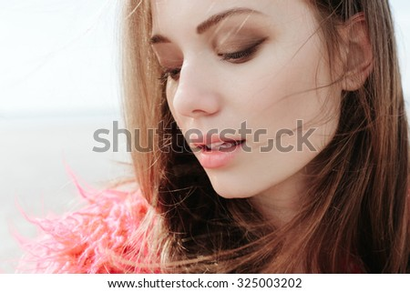 outdoors closeup of Young female model . Soft sunny colors
