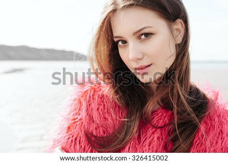 outdoors closeup of Young female model . Soft sunny colors - stock photo