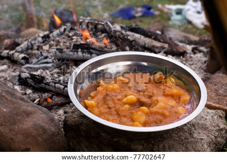 Outdoors cooked stew boiling on the fire 2 - stock photo