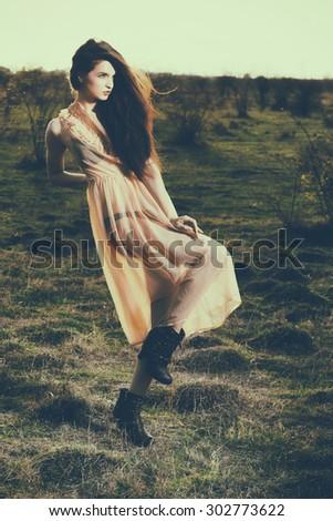 Outdoors fashion photo of beautiful bohemian lady at sunset - stock photo