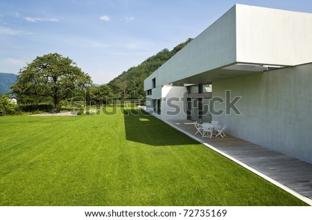 outdoors modern house with green garden - stock photo