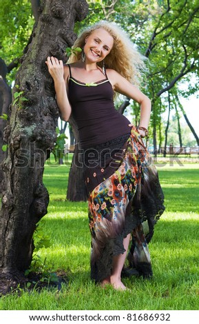 Outdoors portrait of slim smiling young woman