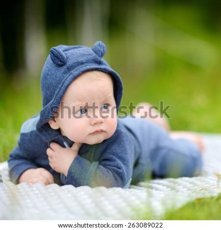 Outdoors portrait of sweet little baby boy  - stock photo