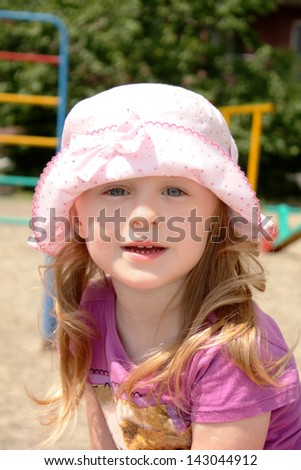 Outdoors portrait of the lovely little girl