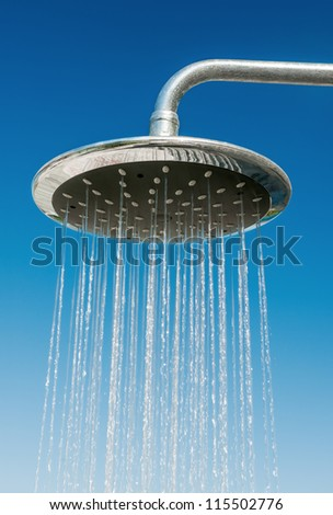 Outdoors shower pouring water against blue sky