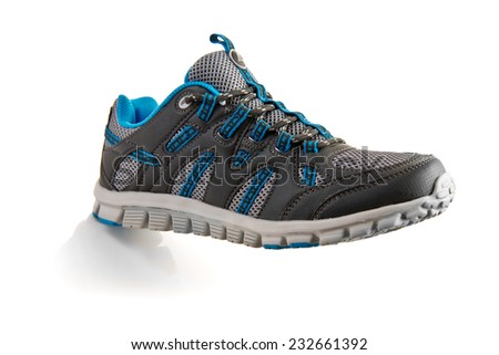 outdoors trainers over a white background - stock photo