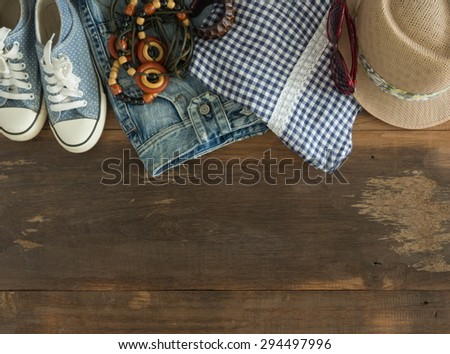 Outfit of casual woman. Top view of clothing and accessory for women. - stock photo