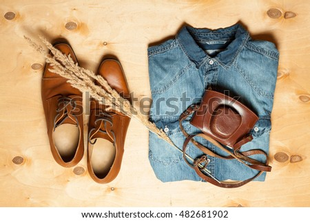 Outfit of modern creative men.Overhead of essentials for traveler, student, businessman. Rustic fashion.