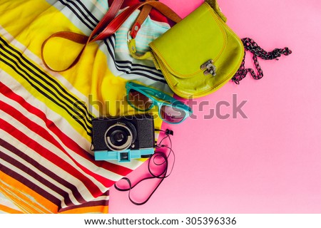 Outfit of student, teenager, young woman or girl . Overhead of essentials for modern young person. Different objects on pink background . Bright summer  colors. Area view. - stock photo