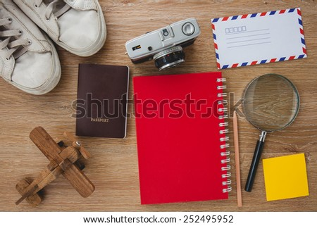 Outfit of traveler, Different objects on wooden background. - stock photo