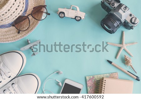 Outfit of traveler on green background with copy space, Travel concept - stock photo