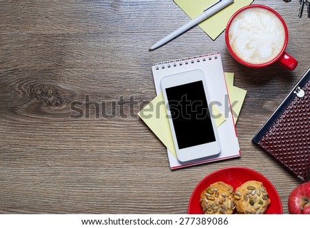 Outfit of woman or girl. Smart phone, notebook, cup of coffee, pen, cookies. Top view. Selective focus - stock photo