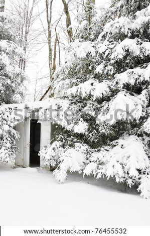 Outhouse for one-room school in a snow-covered landscape, Webster County, Wets Virginia, USA - stock photo
