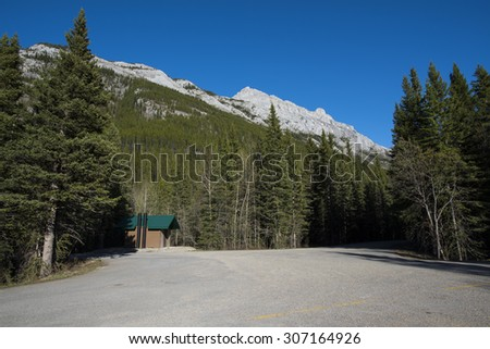 Outhouse in a mountain parking lot, Kananaskis Country Alberta Canada - stock photo