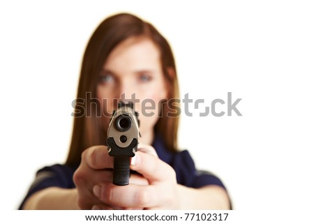 Outlet of a pistol being held by a police woman - stock photo
