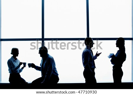 Outline of businesspersons interacting each other - stock photo