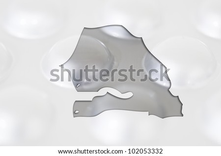 Outline senegal map with transparent background of capsules symbolizing pharmacy and medicine
