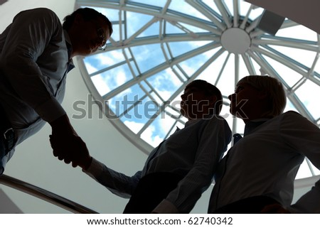 Outlines of business people handshaking after making agreement - stock photo