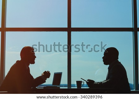 Outlines of two businessmen having meeting - stock photo