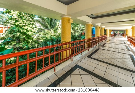 Outlook, perspective at the promenade, lounge area, lobby of a luxury tropical, caribbean hotel. Interior design. - stock photo