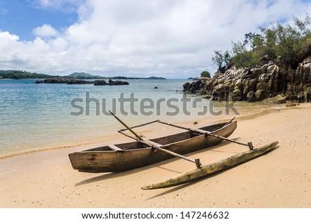 Outrigger canoe on the beach of Nosy Be, Madagascar - stock photo