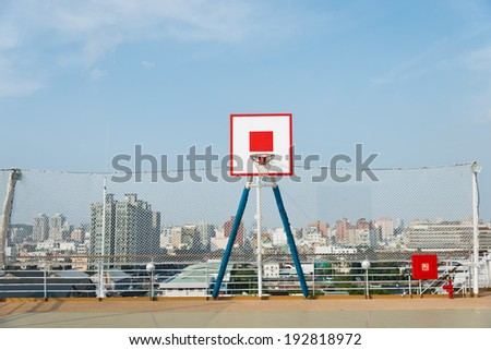 outside basketball court on the roof. - stock photo
