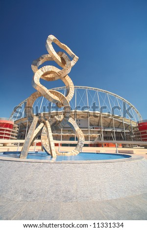 Outside Khalifa sports stadium in Doha, Qatar, Middle East, where the 2006 Asian games were hosted and location for the proposed 2016 Olympic Games (wide angle lens distortion on edges) HDR Image