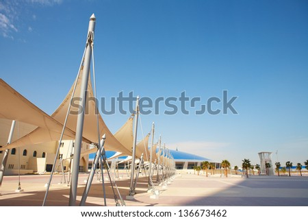 Outside Khalifa sports stadium in Doha, Qatar, Middle East, where the 2006 Asian games were hosted and location for the proposed 2016 Olympic Games (wide angle lens distortion on edges)