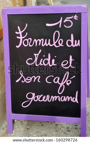 Outside menu sign for lunch at French restaurant  - stock photo