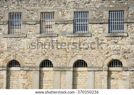 Outside of prison with bars - stock photo