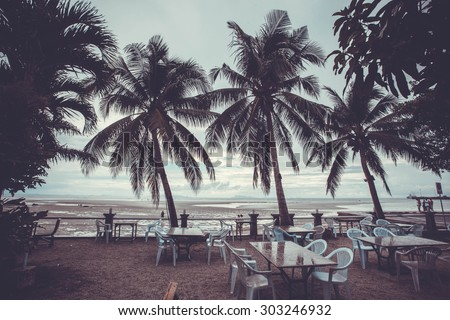 Outside restaurant at the beach in rain time with palms tree. Koh Samui Nathon - stock photo
