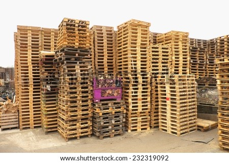 Outside stock of old manufactured wooden standard euro pallets - stock photo