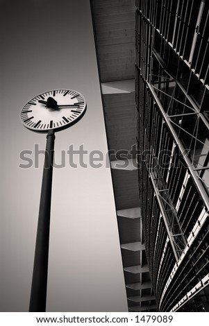 Outside the TGV and ICE Train Station with a clock in Aix-en-provence, France.  Copy space.. Black and white.  Copy space. - stock photo