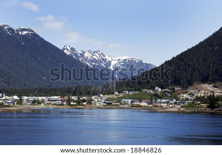 Outskirts of Sitka town with mountains in a background (Alaska). - stock photo