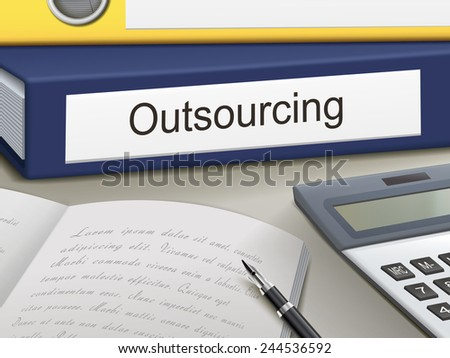 outsourcing binders isolated on the office table - stock photo