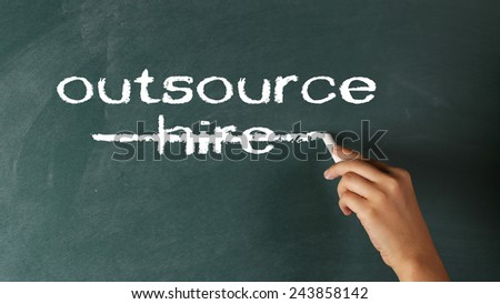 Outsourcing Concept on Blackboard - stock photo