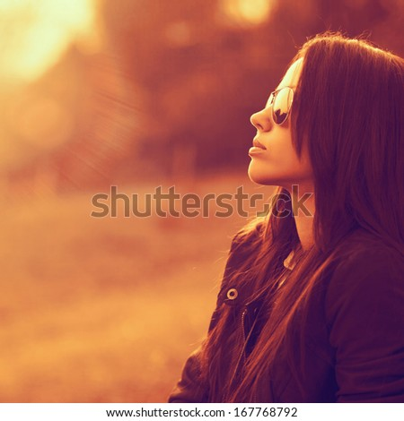 Outstanding portrait of beautiful brunette woman looking to the sun wearing sunglasses. Outdoor. Close up - stock photo