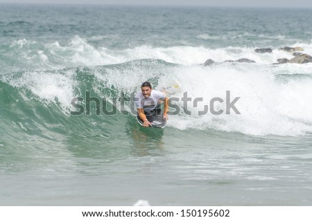 OVAR, PORTUGAL - AUGUST 15: Gastao Entrudo at the 2nd Stage of the Bodyboard Protour 2013 on august 15, 2013 in Ovar, Portugal.