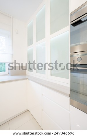 Oven and microwave unit in modern kitchen - stock photo
