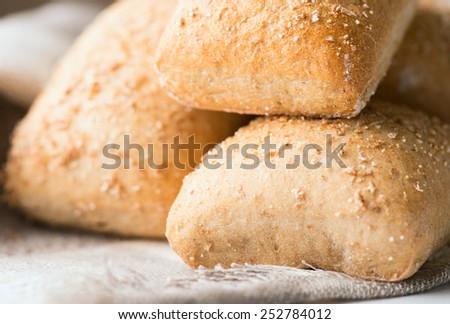 Oven baked bread on napkin. Selective focus. Shallow DOF - stock photo
