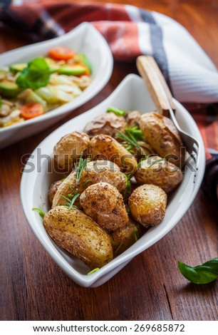 Oven baked potatoes with cabbage salad - stock photo