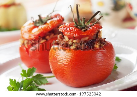 Oven baked stuffed tomatoes filled with rice and ground beef - stock photo
