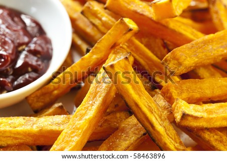 Oven-baked sweet potato fries, with a dipping sauce.