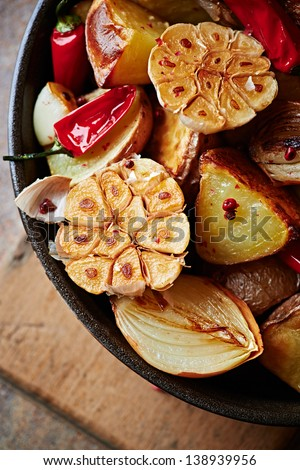 Oven-baked vegetables in a pan - stock photo