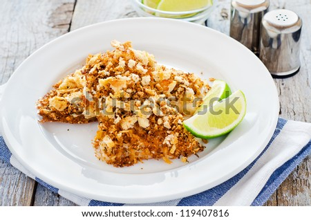Oven cooked fish with bread crust - stock photo